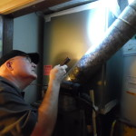 During home inspections, Ron Lane checks water heater components